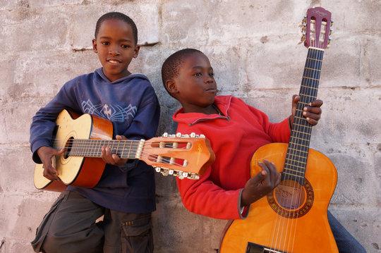 Students playing guitar at Ntonga