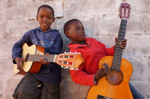 Students playing guitar at Ntonga