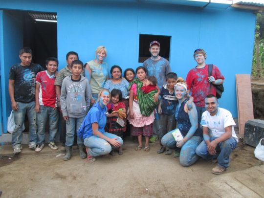 Tomas' Family & Volunteers with Their New Home