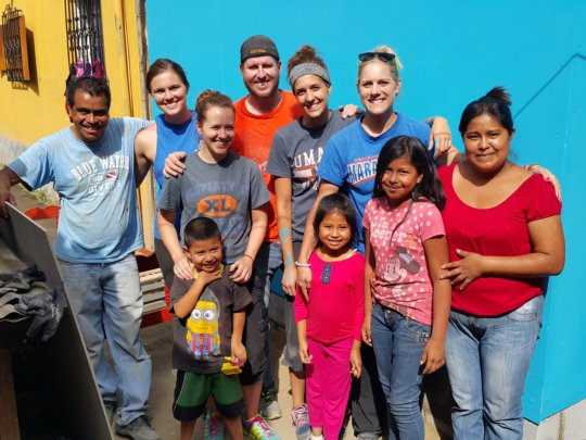 Eslyn's family and volunteers with the new home