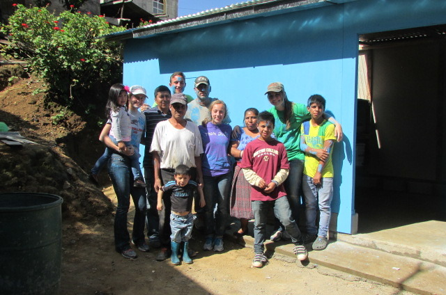 Gloria & her family & volunteers with the new home