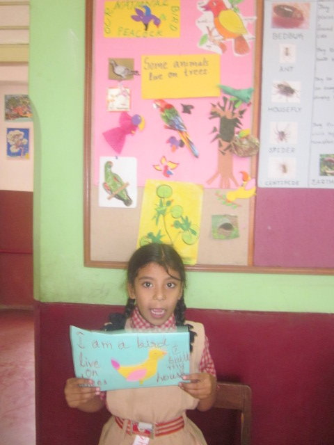 SIS Student displaying her project
