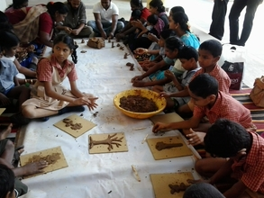 SIS students busy  in Pot painting and Terracotta