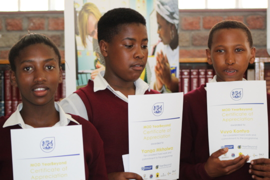 Learners with their certificates