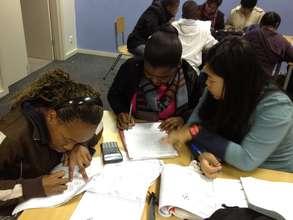 International volunteers helping learners