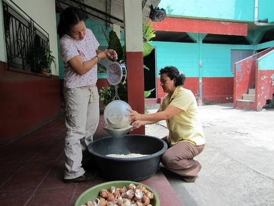 Mercedes Tejada (right) helps at a workshop