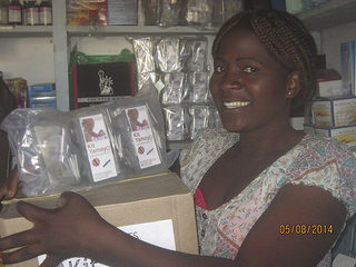 Shopkeeper Christine with new stock