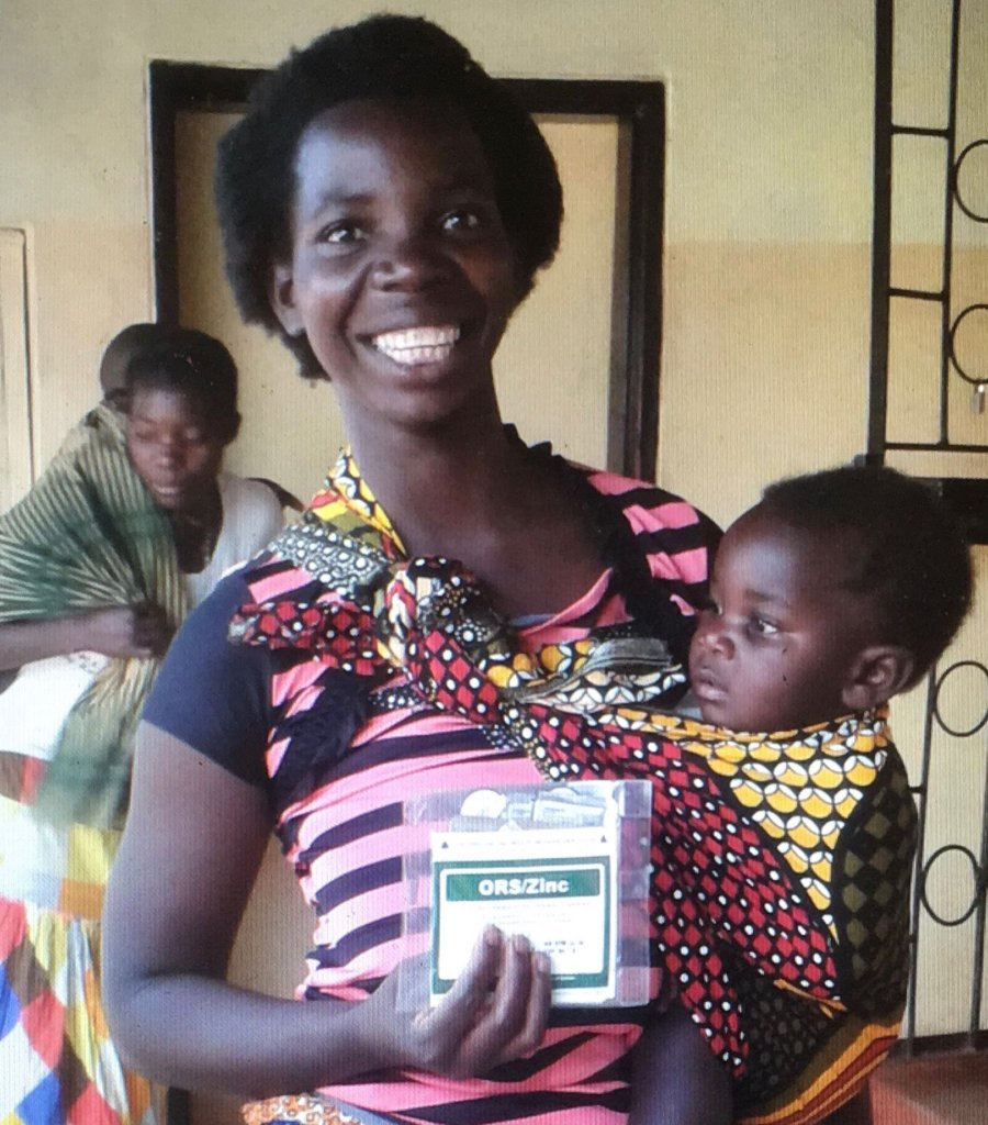 Woman & child with our ORSZ pack-Chinsali district