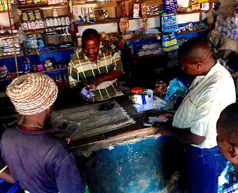 Mr Phiri demonstrates Kit Yamoyo to new customers