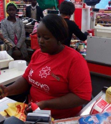 Trained supermarket cashiers promote Kit Yamoyo