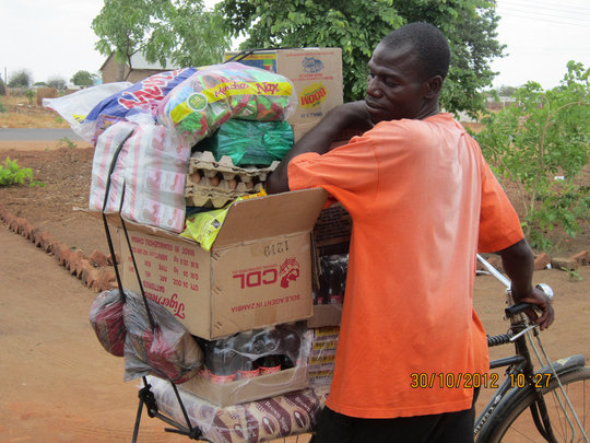 Shopkeeper takes Kit Yamoyo AidPods to his village
