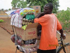 Shopkeeper takes Kit Yamoyo AidPods to his village
