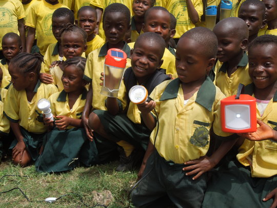 Obama Elementary School children with solar lamps
