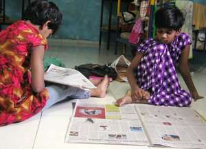 The girls enjoy reading the newspaper