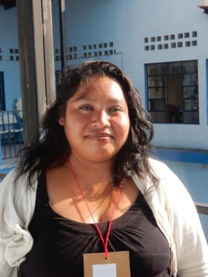 Maya explaining benefits of program for her family