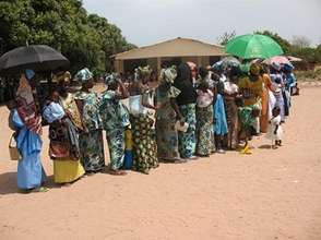 Women Standing in Line to Receive Medical Care