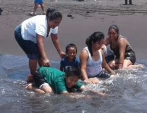 Mothers and kids at the beach