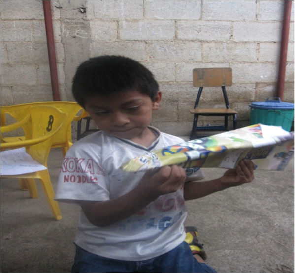 El Rosario boy with airplane October 2014