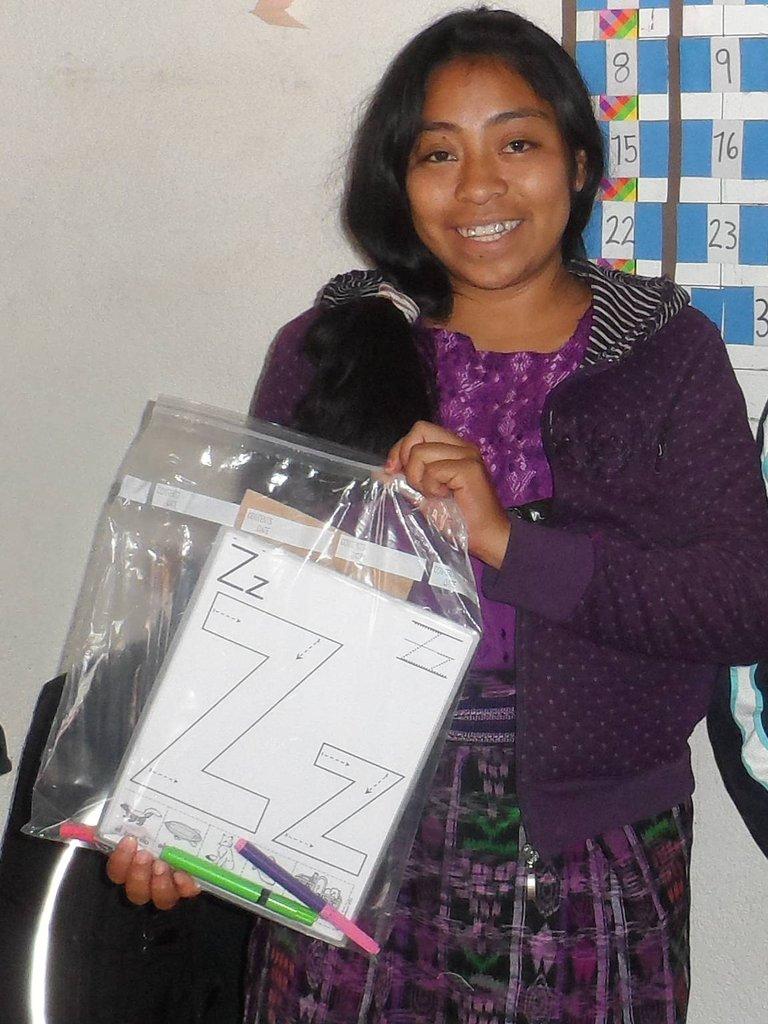 Teacher with materials