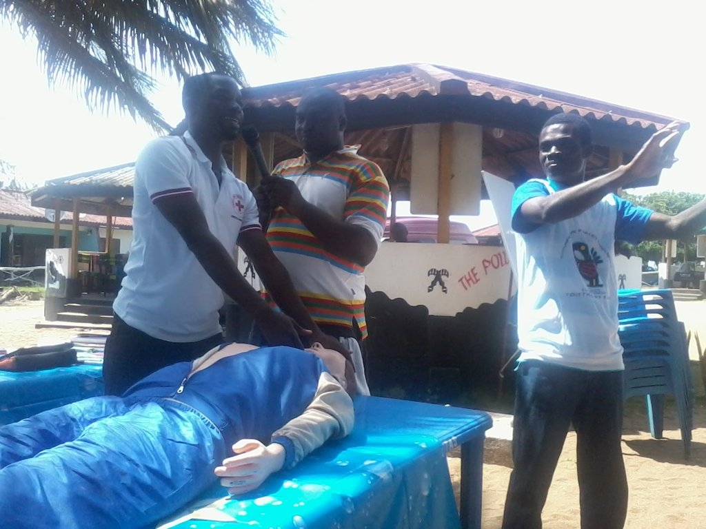 A Red Cross team demonstrates how to do CPR