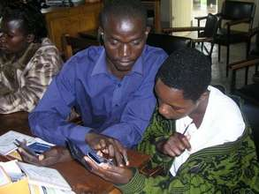Students earnestly examine their new PDAs