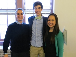Kyle (left) and Susan (right) pose with a student
