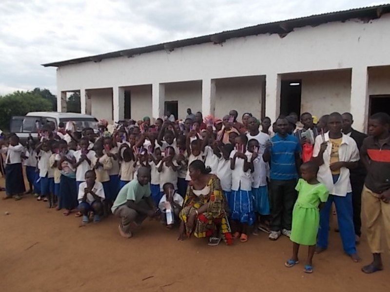 Rwenena kids celebrating with pencils & pens