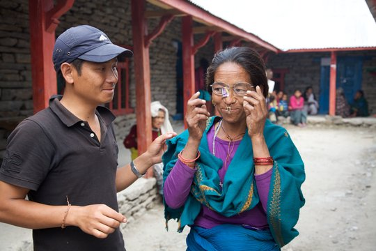 Patient trying on eyeglasses, Lapa Village