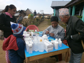 Distributing medicine at an HHC clinic in Ilam
