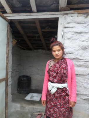Proud Toilet Recipient and Her Toilet in Sertung