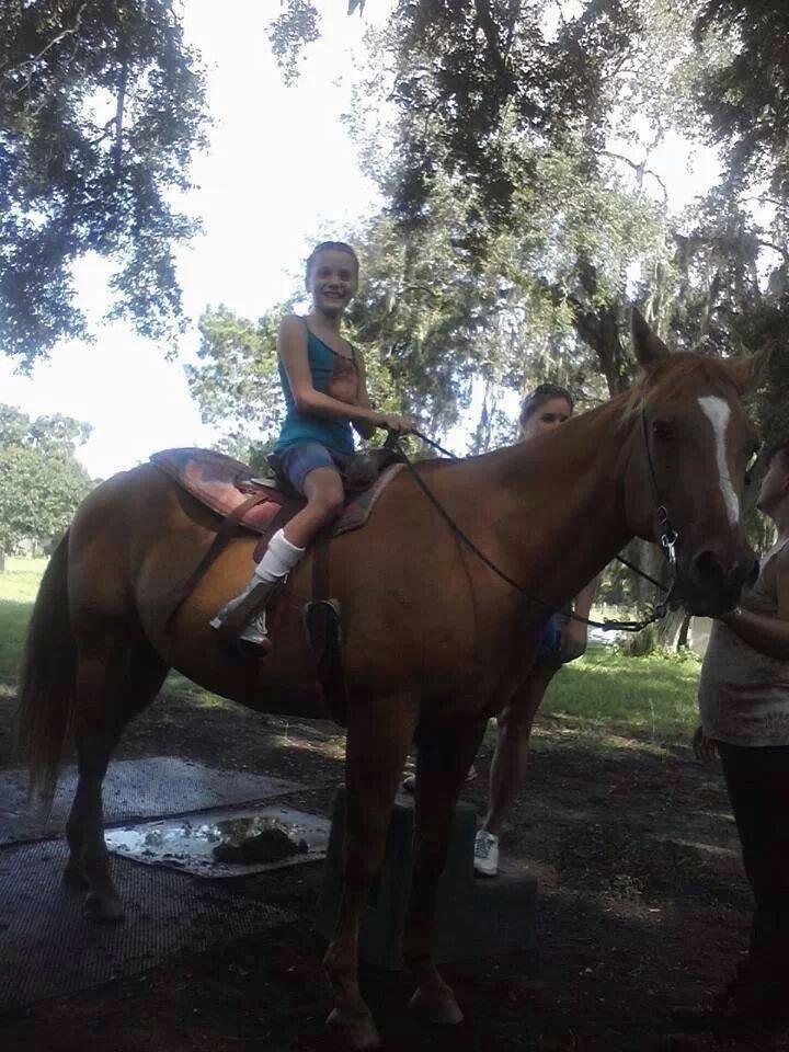 Kirsten who has Cerebral Palsy enjoying her ride!