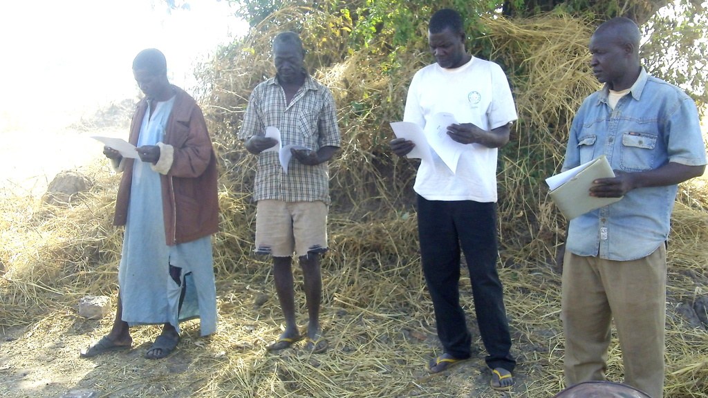 KOSGUELBE group leaders reading pyrolysis manual.