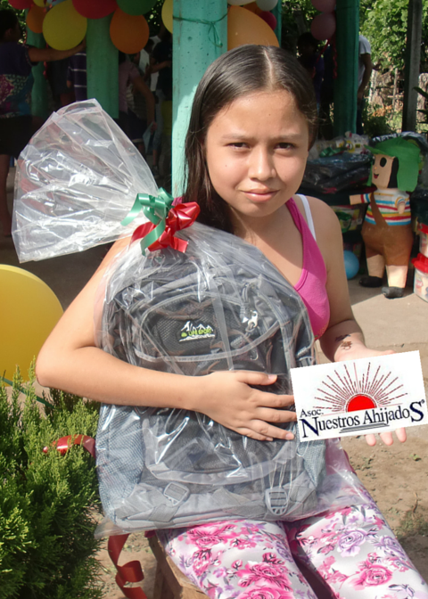 Melany recieving her new backpack for school!