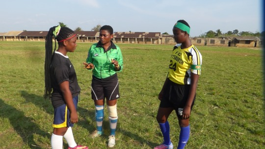 Girls discuss with a peer referee before kick off