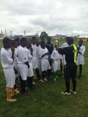 Players engage referee to refresh coaches' lesson