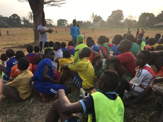 Coach Divine inspiring youth in Metta Quarter