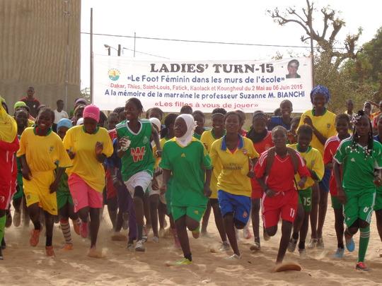 Girls run under the banner for Suzanne M. Bianchi