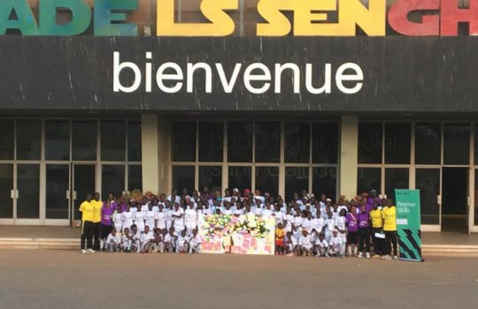 Girls and coaches outside the national stadium.
