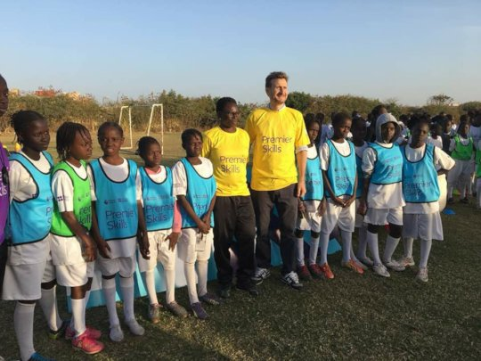 Girls w/ Premier League official get ready to play