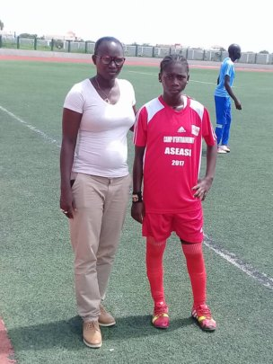 Seyni and player at a girls' soccer camp.