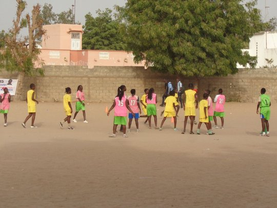 Girls play- in Senegal, soccer is a sand sport.