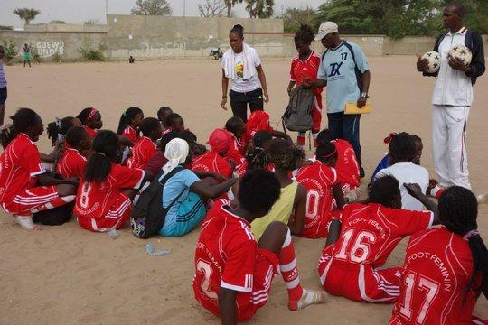 P.E. Teacher, Coach in Thies mentoring her team
