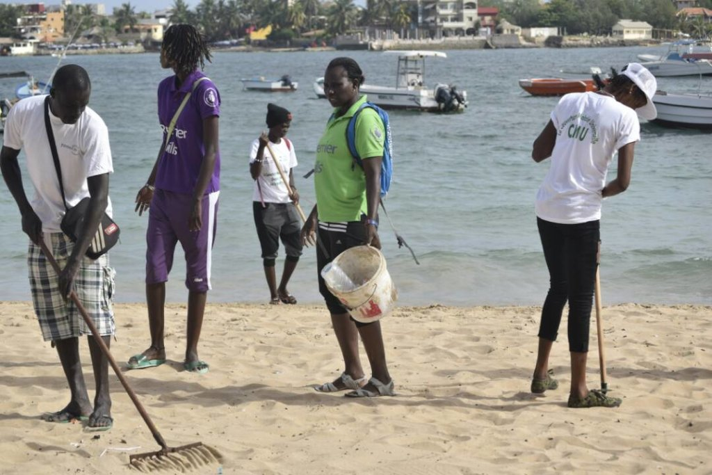 Set Setal: Young women players clean Ngor beach.