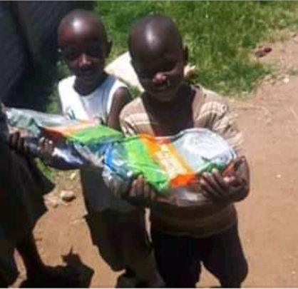 Food donation by Hon. Ms. Rozaah Buyu