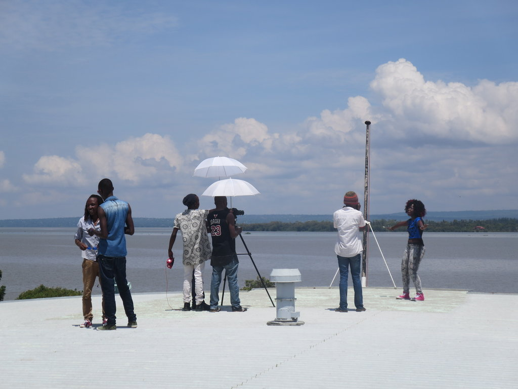 Nahna (r) and video crew at Lake Victoria, Kisumu