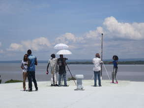 Nahna (r) and video crew at Lake Victoria, Kisumu