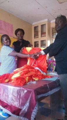 Coach Carina gives uniforms to Shaurimoyo School