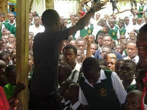 Gabiro performs at a secondary school