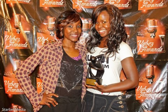 Nahna with Vybez trophy and friend