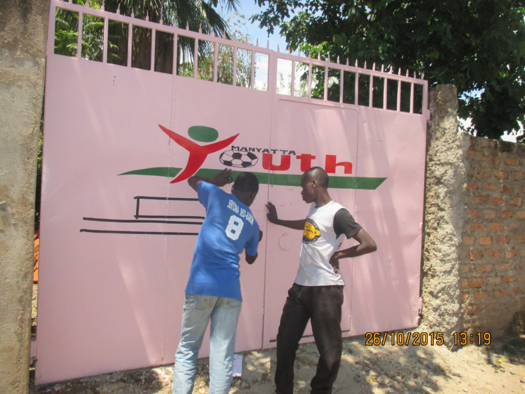 Our logo goes up on gate of the new office